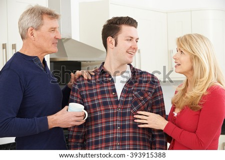 Portrait Of Family With Adult Son At Home - stock photo