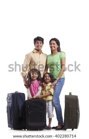 Portrait of family with suitcases - stock photo