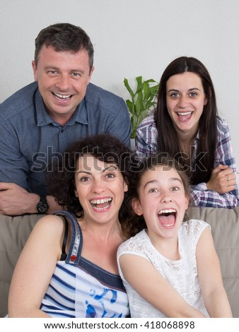 Portrait of  family with two children at home  - stock photo