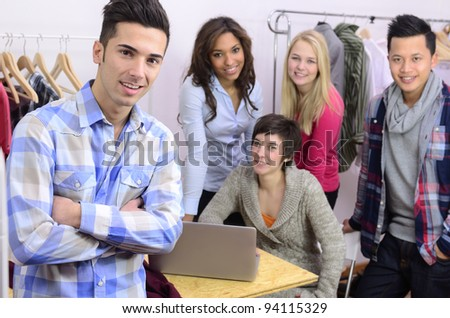 portrait of fashion designer team at work at office