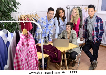 portrait of fashion designer team at work at office - stock photo
