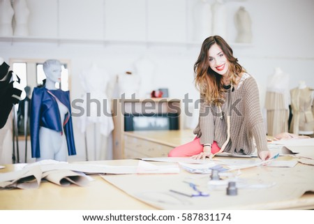 Portrait of Fashion designer working in her studio