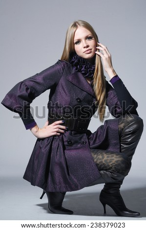 portrait of fashion girl posing in the studio