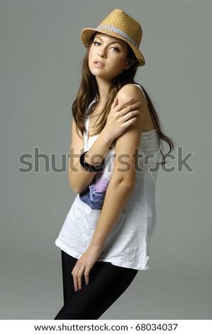 portrait of fashion girl wearing hat taking pose - stock photo