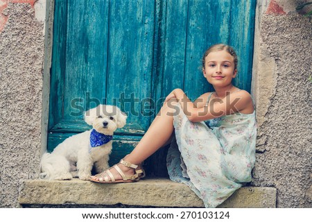 Portrait of fashion girl with Maltese dog, Italy - stock photo