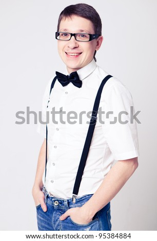 Portrait of fashion men in suspender with bow tie and glasses