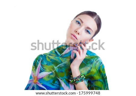 Portrait of fashion model long-haired girl with stylish colorful dress and bright bracelet, isolated on white background - stock photo