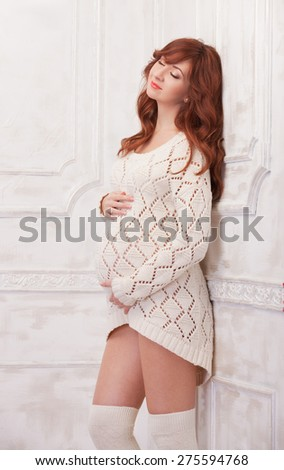 Portrait of fashion pregnant woman - stock photo
