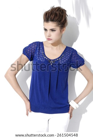 Portrait of fashion shot of girl posing in light background  - stock photo