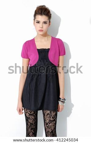 Portrait of fashion shot of girl standing in studio - stock photo