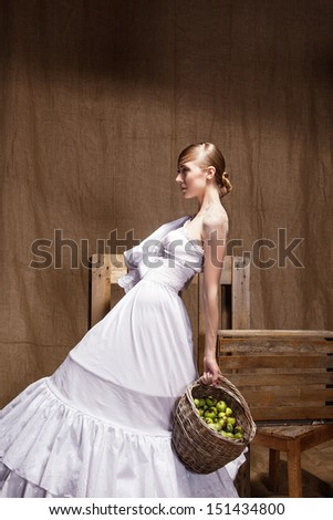 Portrait of  Fashion studio shot woman in Wedding dress. Professional makeup and hairstyle - stock photo