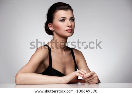 Portrait of fashion woman in  black dress on natural background