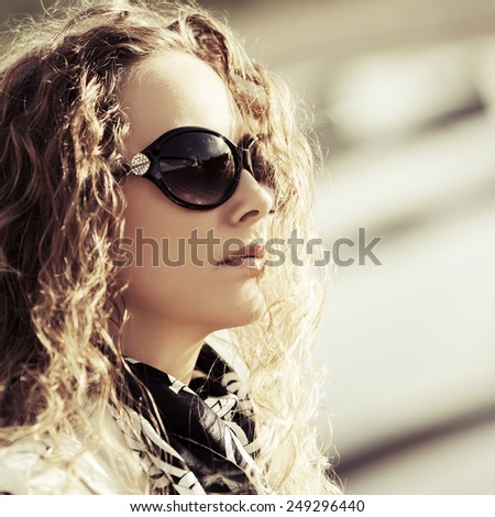 Portrait of fashion woman with long curly hairs outdoor  - stock photo