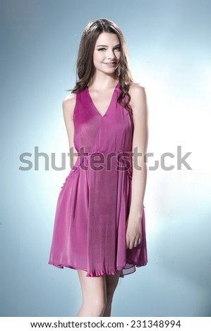 Portrait of fashion young woman posing in studio - stock photo