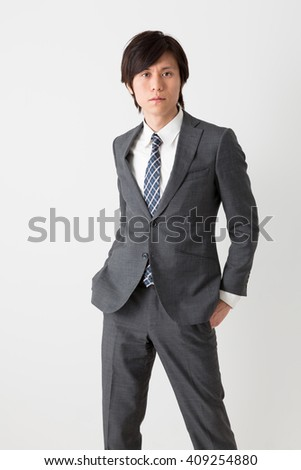 portrait of fashionable asian businessman isolated on white background