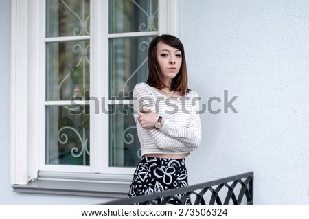 Portrait of fashionable brunette girl with beautiful brown eyes - stock photo