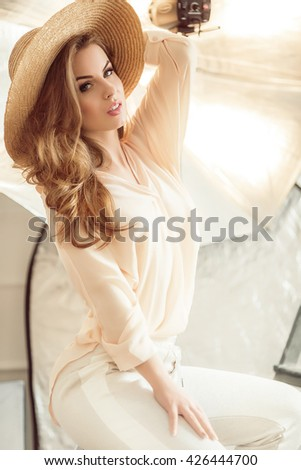 Portrait of fashionable girl with a hat