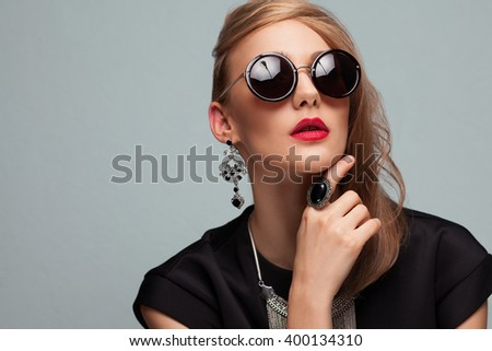 Portrait of fashioned woman in stylish sunglasses