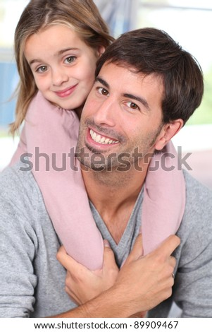 Portrait of father and child having fun together