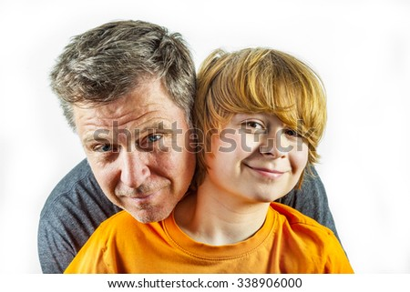 portrait of father and happy son hugging