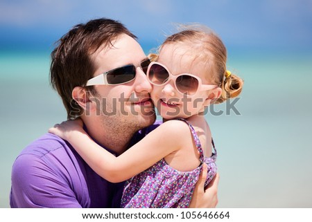 Portrait of father and his little daughter on vacation