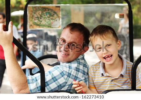 Portrait of father and son outdoors - stock photo