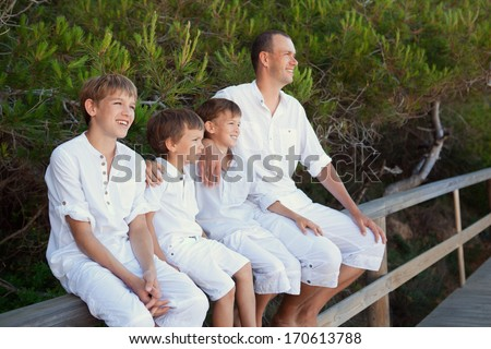 Portrait of father and three sons, outdoor - stock photo