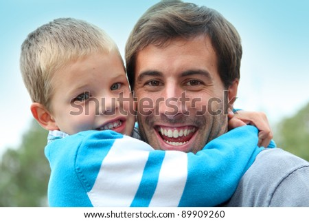 Portrait of father holding child in arms