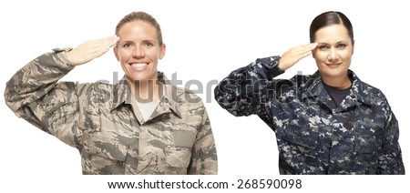 Portrait of female airman and female sailor saluting against white background - stock photo