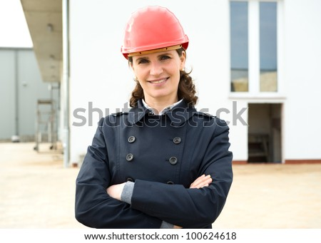 Portrait of female architect in front of new industry building - stock photo