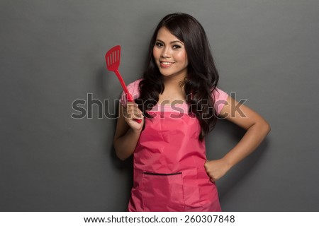 portrait of female chef or house wife ready to cook - stock photo