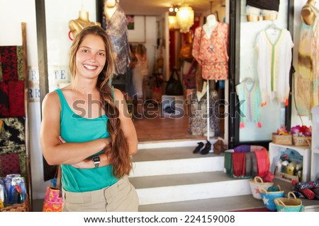 Portrait Of Female Clothing Shop Owner - stock photo