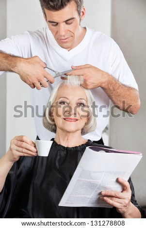 Portrait of female customer having haircut at beauty parlor - stock photo