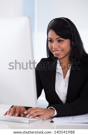 Portrait Of Female Customer Representative Using Computer - stock photo