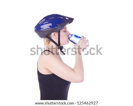 Portrait of female cyclist drinking water against white background