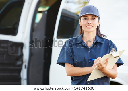 Portrait Of Female Delivery Driver With Clipboard - stock photo