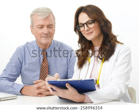Portrait of female doctor doing medical check up with senior patient. Isolated on white background.  - stock photo