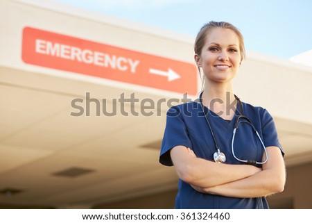 Portrait Of Female Doctor Standing Outside Hospital - stock photo