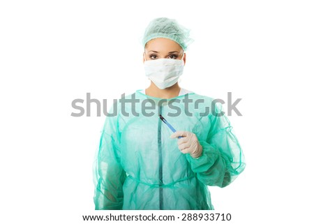 Portrait of female doctor with a scalpel.
