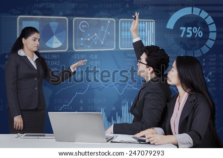 Portrait of female entrepreneur lead a business meeting and let her team member to ask