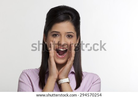 Portrait of female executive shouting