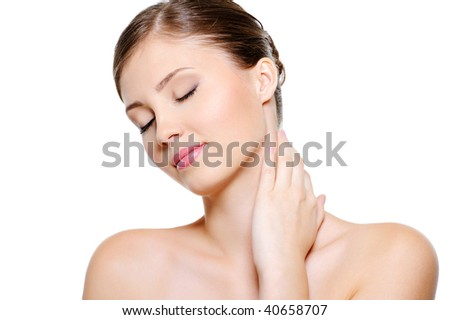 Portrait of  female face  with  a closed eyes stroking her neck over white background - stock photo