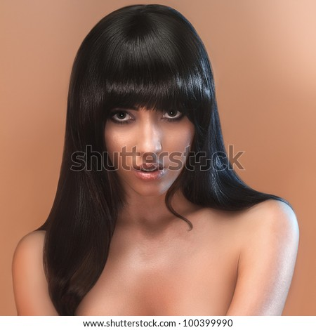 portrait of female face with long beauty glossy dark hair - stock photo