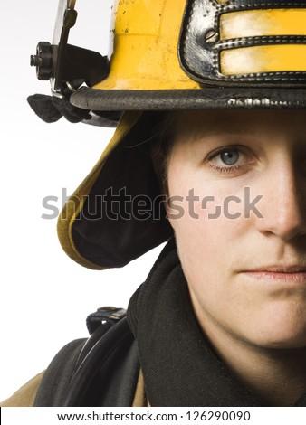 Portrait of female firefighter - stock photo