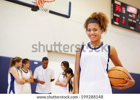 Portrait Of Female High School Basketball Player - stock photo