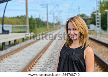 Portrait of female in black top on the railway - stock photo