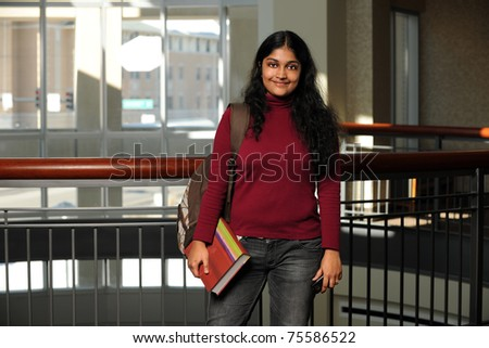 Portrait of female Indian student indoors - stock photo