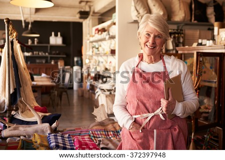 Portrait Of Female Owner Of Gift Store With Digital Tablet - stock photo