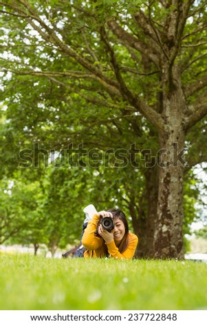 Portrait of female photographer at the park - stock photo