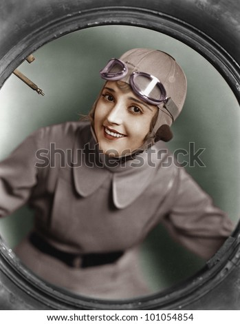 Portrait of female pilot - stock photo
